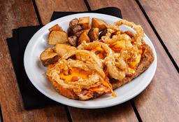 Milanesa cheddar con papas fritas o puré
