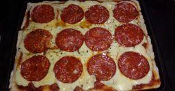 Porción de Pizza Rellena Cantimpalo